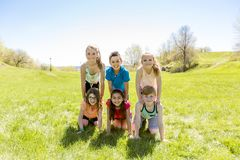 Group of child have fun on a field Stock Photography