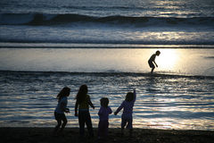 A Group of Children at Beach. Young Children Playing on the Beach at Sunset Royalty Free Stock Photo