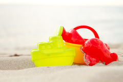 Group of children beach toys on seacoast. Group of children beach plastic toys on seacoast. Surface level. Summer vacation Stock Photo