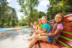 Group of children on the bench in park Royalty Free Stock Images