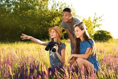 Group of children with binoculars in field Royalty Free Stock Photos