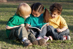 Group of children with the book Royalty Free Stock Image