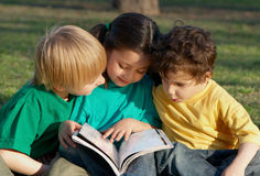 Group of children with the book Royalty Free Stock Photography