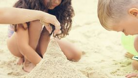 Group of little children build a sand tower. Group of children build a sand tower, close-up image Stock Photo