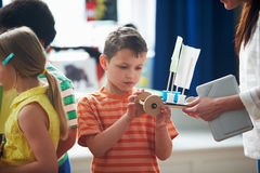 Group Of Children Carrying Out Experiment In Science Class Stock Images