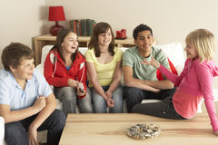 Group Of Children Chatting At Home. Smiling stock photo