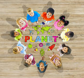 Group of Children in Circle with Planet Message Royalty Free Stock Photography