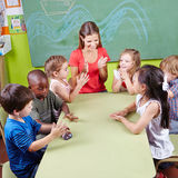 Group of children clapping hands. In kindergarten in musical education class Royalty Free Stock Photo