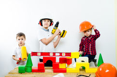 A group of children with construction tools, isolate of white background stock photo