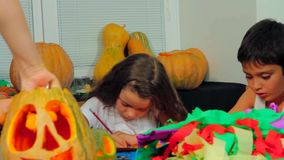 Group Of Children Crafting Preparing For Halloween stock video
