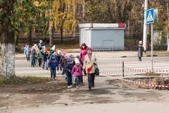 A group of children crosses the carriageway according to the rules of the road royalty free stock images