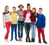 Group of children with different complexion. A group of children with different complexion embracing isolated on white background stock photography