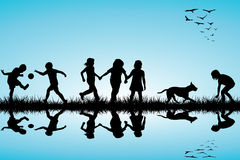 Group of children and a dog playing outdoor Royalty Free Stock Photos