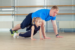 Group of children doing kids gymnastics in gym with nursery teac Stock Image