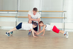 Group of children doing kids gymnastics in gym with nursery teac Stock Photography