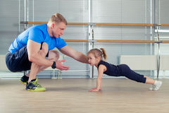 Group of children doing kids gymnastics in gym with nursery teacher Stock Image