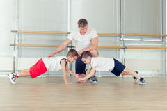 Group of children doing kids gymnastics in gym with nursery teacher Royalty Free Stock Photos