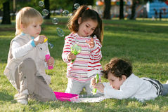 Group of children doing soap bubbles Stock Images