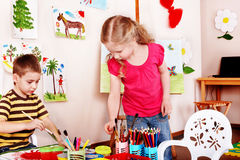 Group children  draw paints in play room. Royalty Free Stock Photography