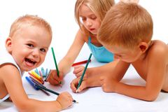 Group of children drawing. A group of children drawing on paper Stock Image