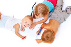Group of children drawing. A group of children drawing on paper Royalty Free Stock Image