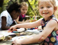 Group of children drawing imagination outdoors royalty free stock image