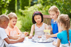 Group of children drinking water together. In friend`s party Royalty Free Stock Images