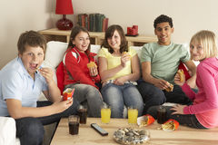 Group Of Children Eating Burgers At Home Stock Images