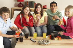 Group Of Children Eating Burgers At Home Royalty Free Stock Image