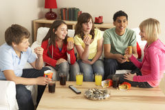 Group Of Children Eating Burgers At Home Stock Photography