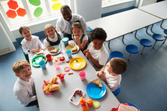 Group Of Children Eating Lunch In School Cafeteria royalty free stock photography