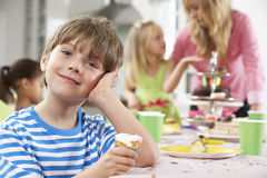 Group Of Children Enjoying Birthday Party Food At Table Stock Photos