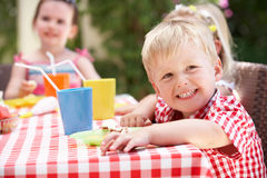 Group Of Children Enjoying Outdoor Tea Party Royalty Free Stock Image