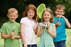 Group Of Children Exploring Nature Together Stock Photos