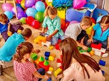 Group children game blocks on floor Stock Photo