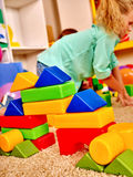 Group children game blocks on floor Royalty Free Stock Image