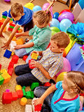Group children game blocks on floor Stock Image
