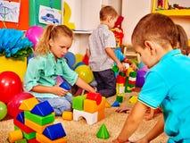 Group children game blocks on floor . Royalty Free Stock Images