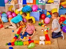 Group children game blocks on floor Stock Images