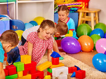 Group children game blocks on floor . Royalty Free Stock Photos