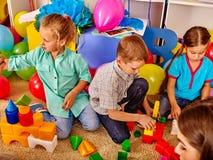 Group children game blocks on rug . Royalty Free Stock Image