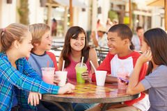 Group Of Children Hanging Out Together In CafŽ Stock Photo