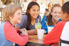 Group Of Children Hanging Out Together In CafŽ Royalty Free Stock Images