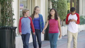 Group Of Children Hanging Out Together In Mall stock video footage