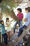 Group Of Children Hanging Out In Treehouse Together Stock Image