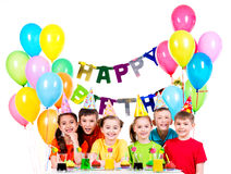 Group of children having fun at the birthday party. Group of happy children in colorful shirts having fun at the birthday party - isolated on a white Royalty Free Stock Photo