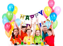 Group of children having fun at the birthday party. Group of happy children in colorful shirts having fun at the birthday party - isolated on a white Royalty Free Stock Images