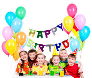 Group of children having fun at the birthday party. Group of happy children in colorful shirts having fun at the birthday party - isolated on a white Stock Photography