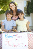 Group Of Children Holding Bake Sale With Mother Stock Photos
