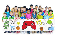 Group of Children Holding Board with Activities Symbol.  stock photo